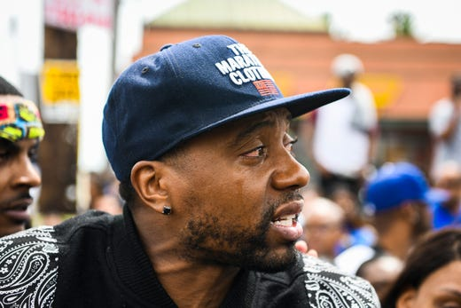Los Angeles Resident Michael Strong mourns the loss of Nipsey Hussle in front of The Marathon Store on the corner of Crenshaw and Slauson on April 11, 2019.
