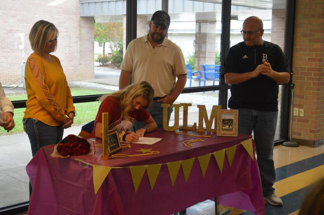 Buckeye senior Allie Tyler (seated) signed with ULM's track and field program Friday.