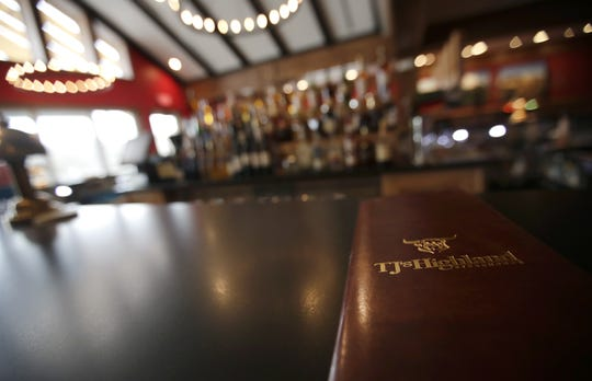 A drink and dessert menu lays on the counter in TJ's Highland Steakhouse's bar Friday, April 12, 2019, in Oshkosh, Wis.  Danny Damiani/USA TODAY NETWORK-Wisconsin