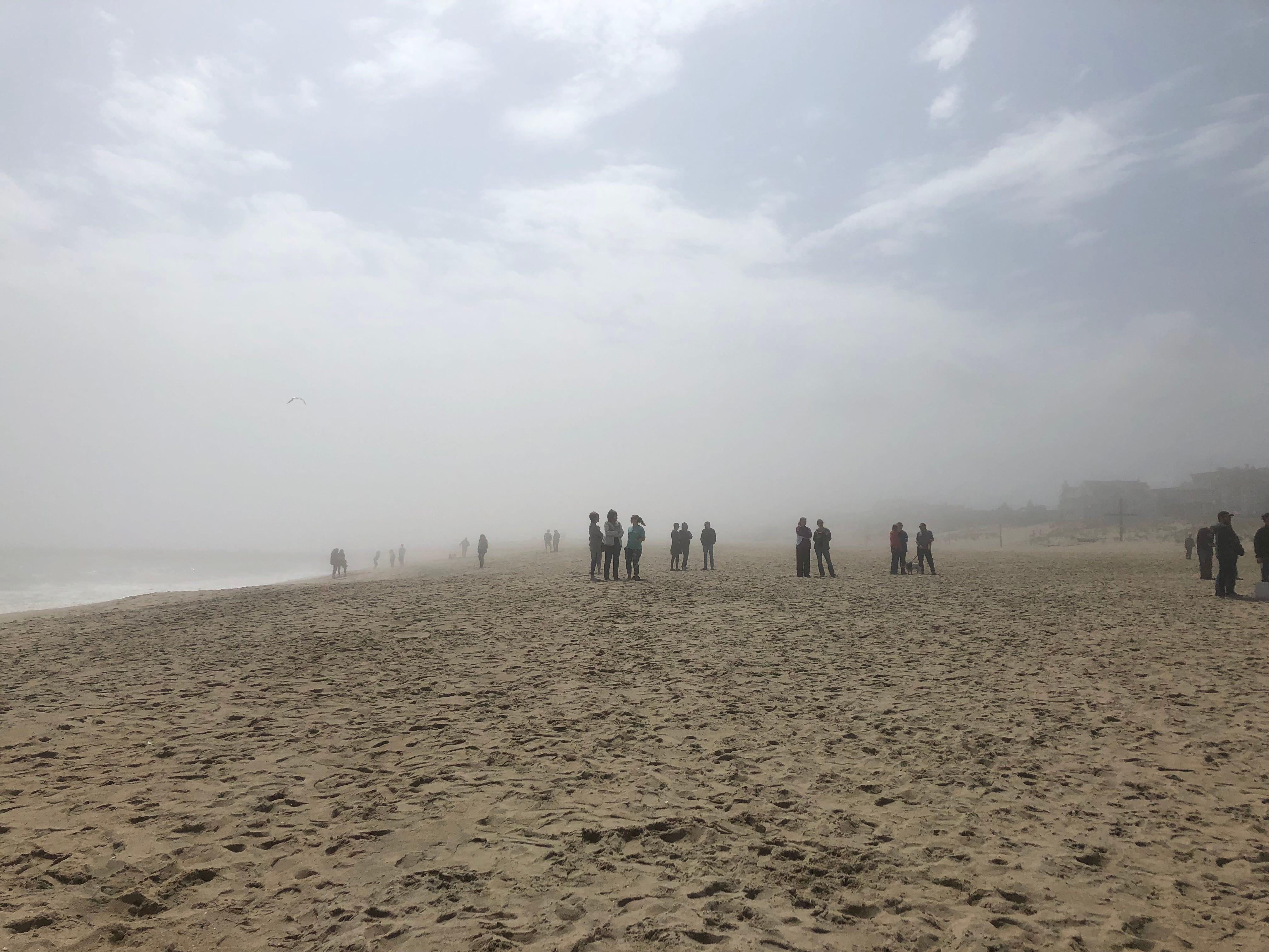 Haze from the fire clouded Ocean Grove's beach Saturday