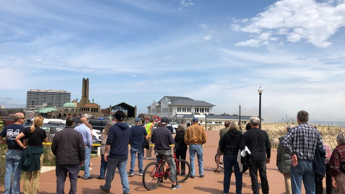 Crowds watch the firefighters battle a fire at Dunes Boardwalk Cafe