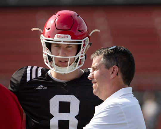 Quarterback Artur Sitkowski talks with offensive coordinator John McNulty during a break in play. 2018 Rutgers Football Scarlet-White game in Piscataway, NJ on April 13, 2019.
