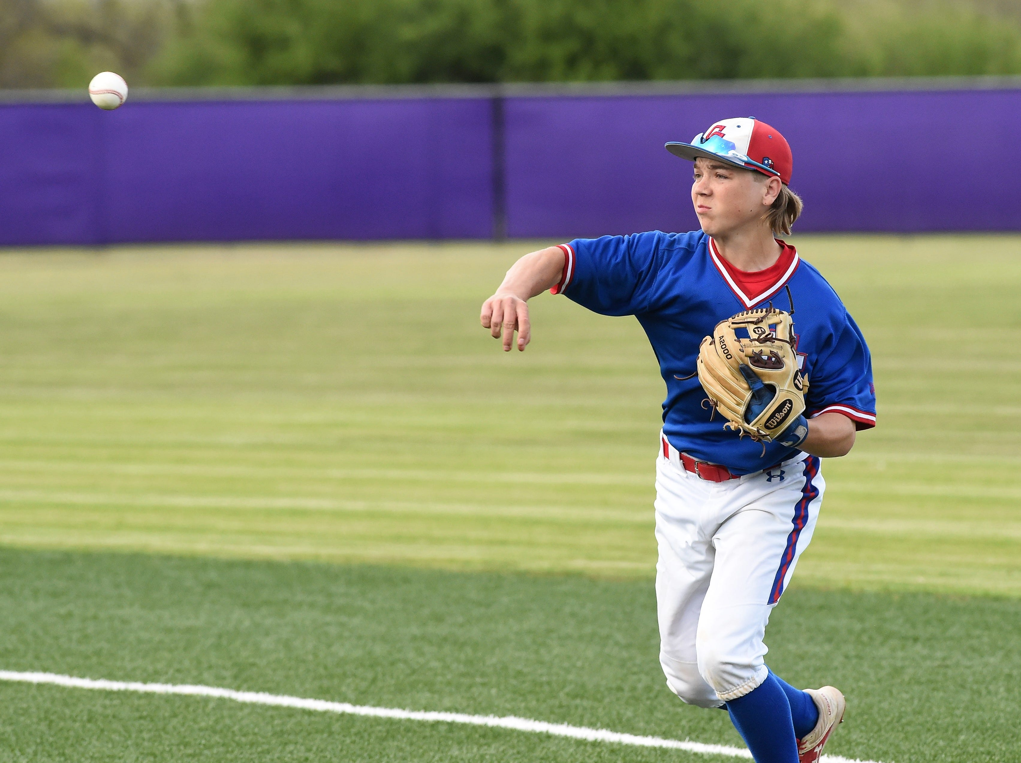 Cooper second baseman Brody Stanford (4) throws to first for an out against Wylie at Bulldog Field on Friday, April 12, 2019. Stanford walked and scored in the Cougars 4-3 loss.