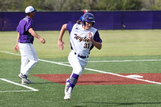 Wylie's Tyler Martin (31) rounds third and scores against Cooper at Bulldog Field on Friday, April 12, 2019. Martin had a hit and scored in the 4-3 win.