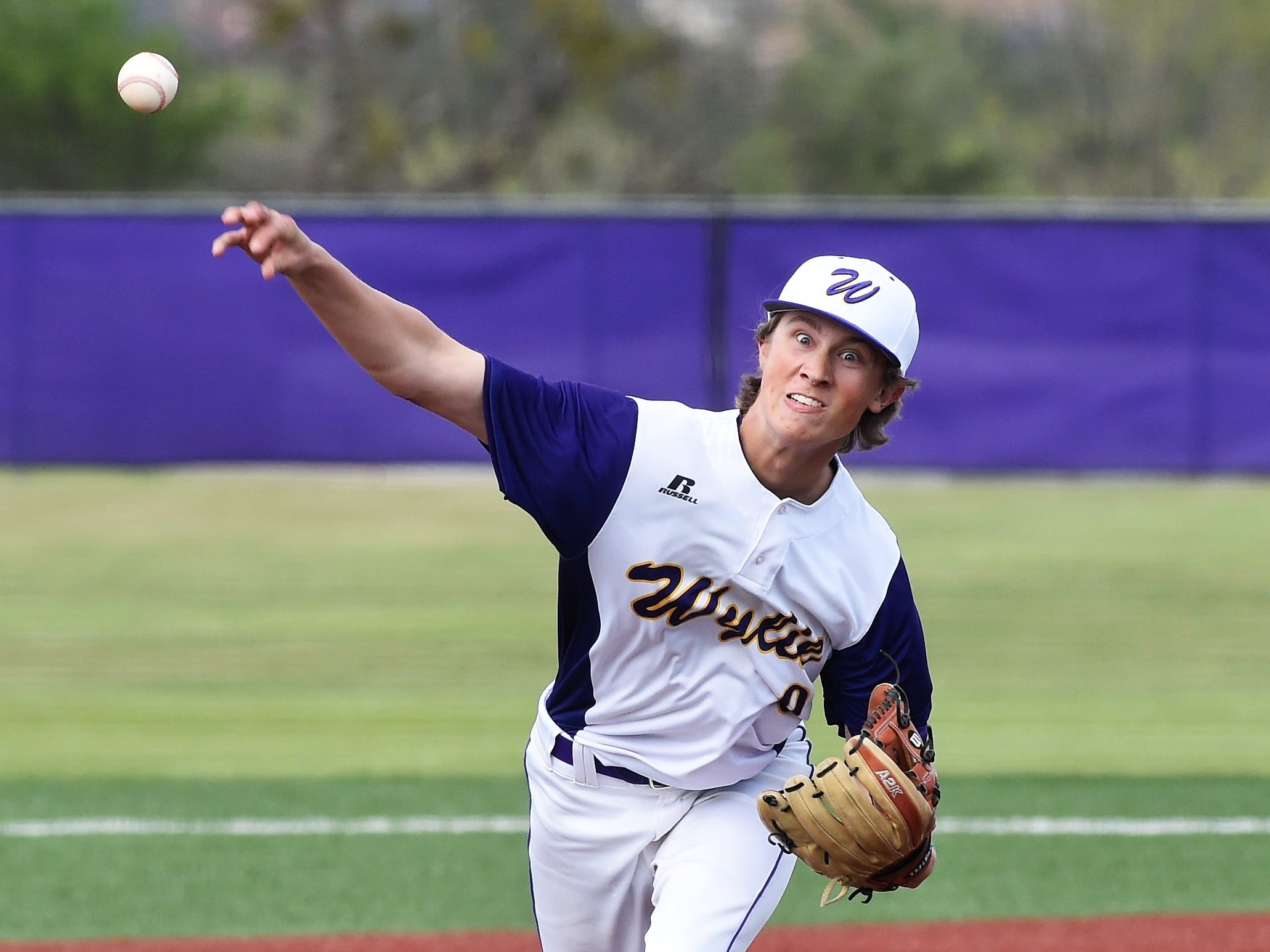 Wylie pitcher Brooks Gay (9) lets go of the ball against Cooper at Bulldog Field on Friday, April 12, 2019. Gay earned the win, giving up one unearned run in six innings on two hits with three strikeouts as the Bulldogs won 4-3.