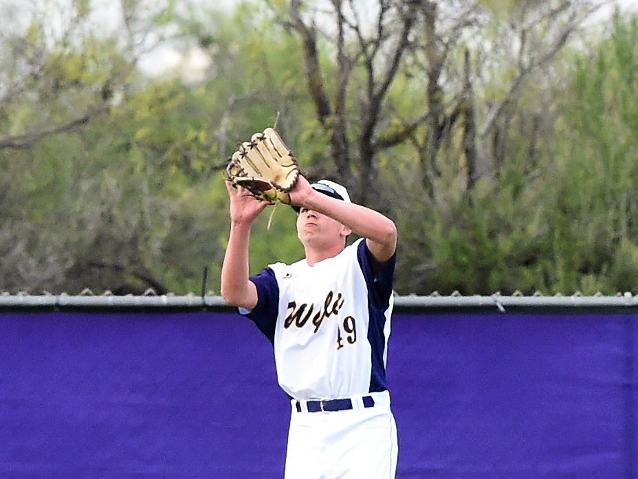 Wylie center fielder Brandon Sanders (19) looks in a fly ball against Cooper at Bulldog Field on Friday, April 12, 2019. The Bulldogs won 4-3.