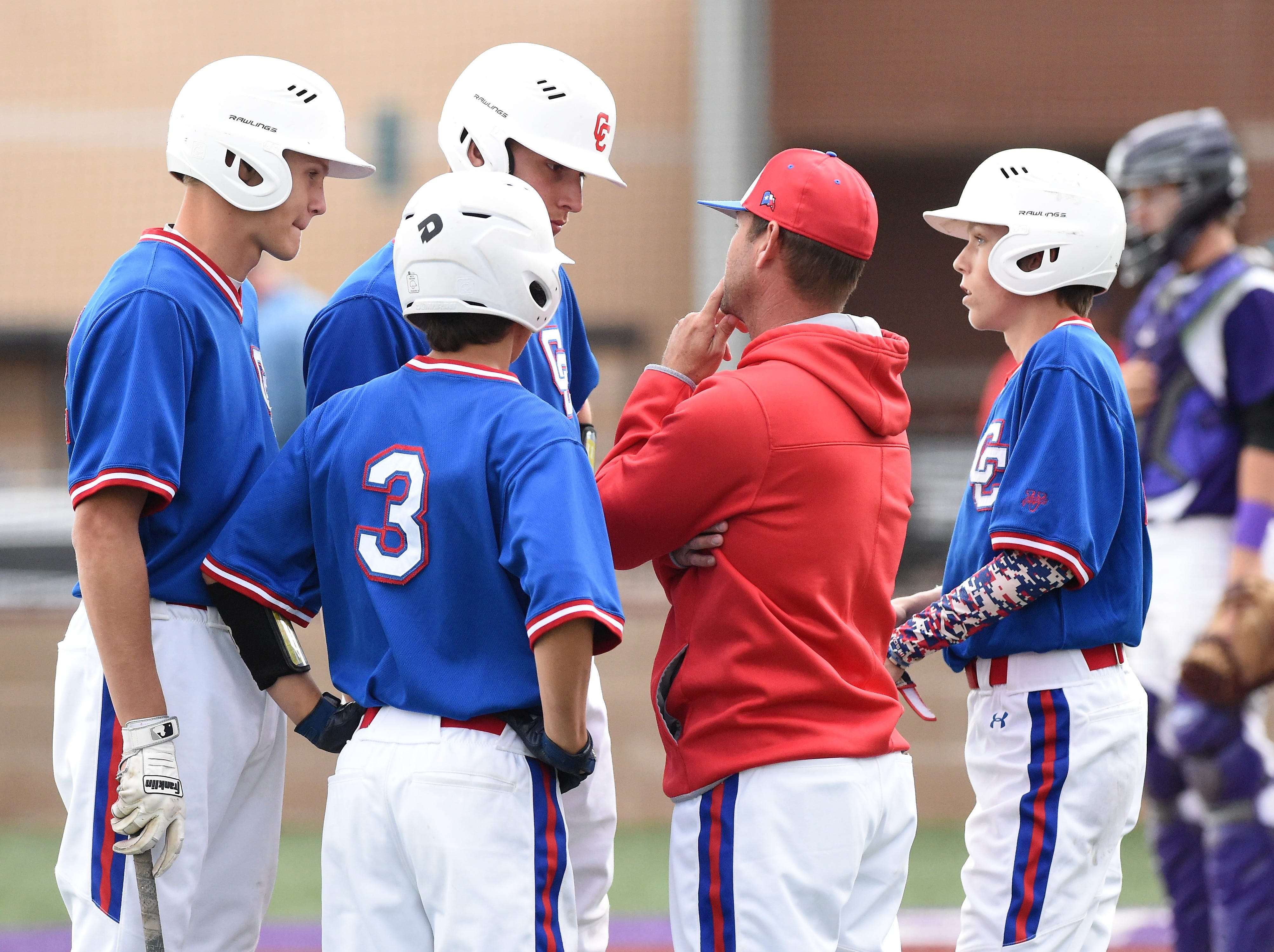 Cooper coach Cody Salyers talks to his players during a Wylie pitching change at Bulldog Field on Friday, April 12, 2019. The Cougars fell 4-3.