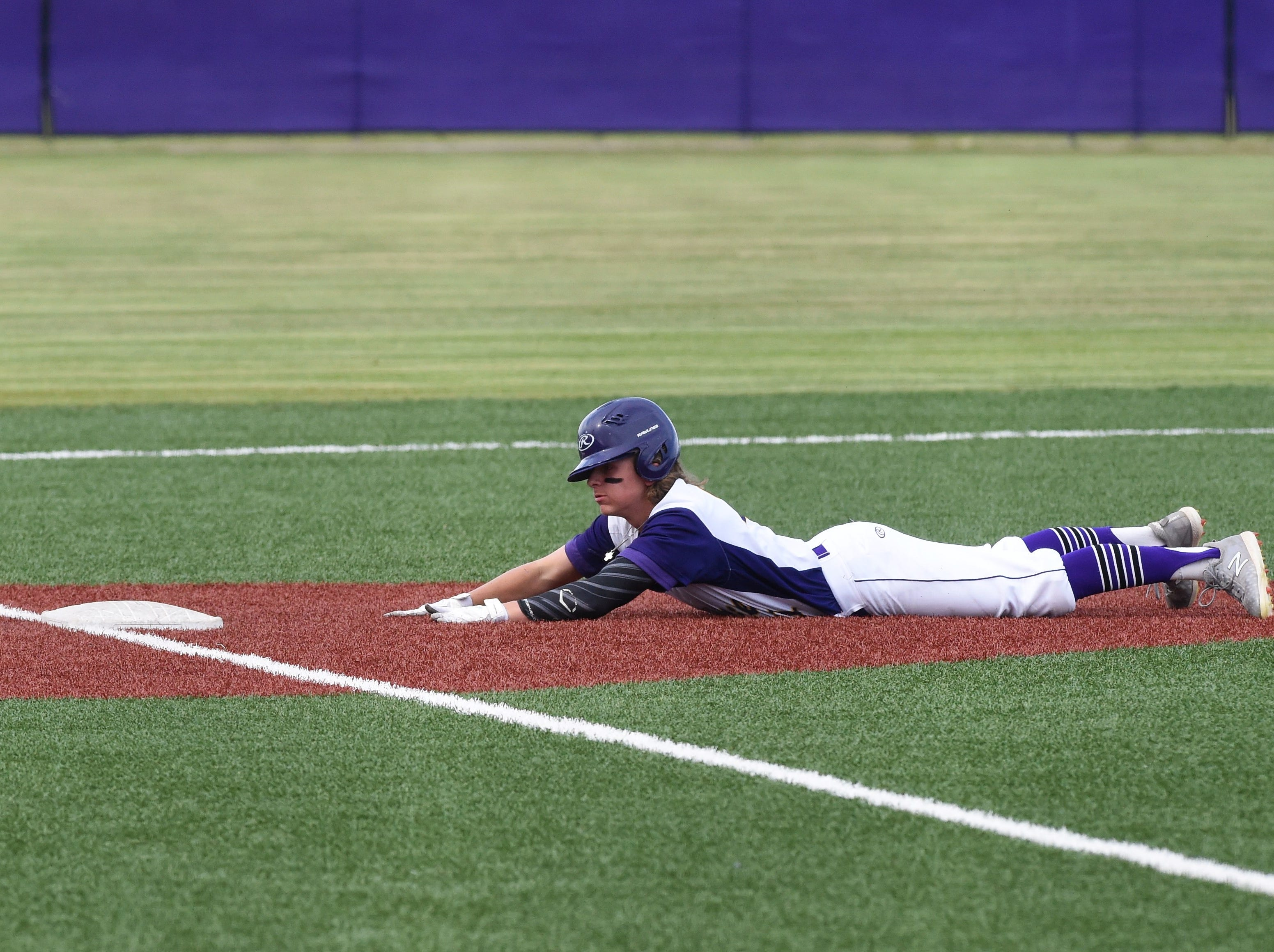 Wylie's Cooper Cothran (21) slides safely into third after stealing second and advancing on an error at Bulldog Field on Friday, April 12, 2019. Cothran would go on to score on another error in the 4-3 win.