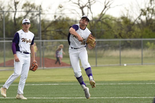 Wylie shortstop Jaxon Hansen (39) throws to first on the run against Cooper at Bulldog Field on Friday, April 12, 2019. Hansen was 6 for 6 on grounders in the 4-3 win.