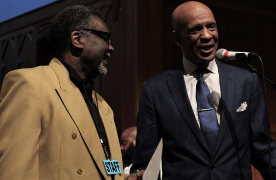Former Dallas Cowboys star receiver Drew Pearson, right, jokes with the Rev. Houston McLendon at Friday evening's benefit for the Rev. Eddie Jordan at St. Paul UMC. April 12 McLendon, pastor of King Solomon Baptist Church and event emcee, mentioned the Philadelphia Eagles, bringing Pearson to the podium to defend the Cowboys.