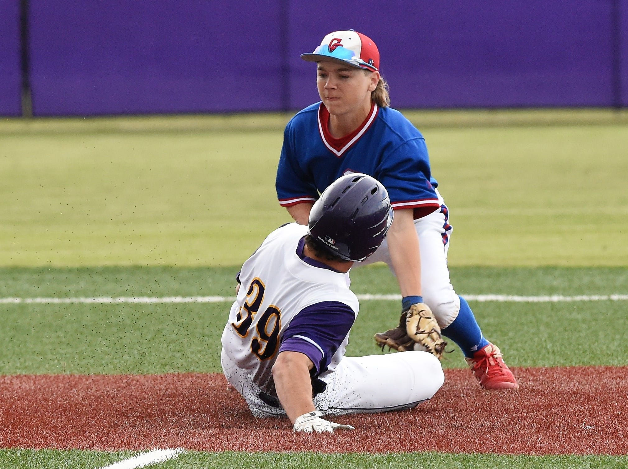 Cooper second baseman Brody Stanford (4) puts the tag on Wylie's Jaxon Hansen (39) at Bulldog Field on Friday, April 12, 2019. Wylie won 4-3.