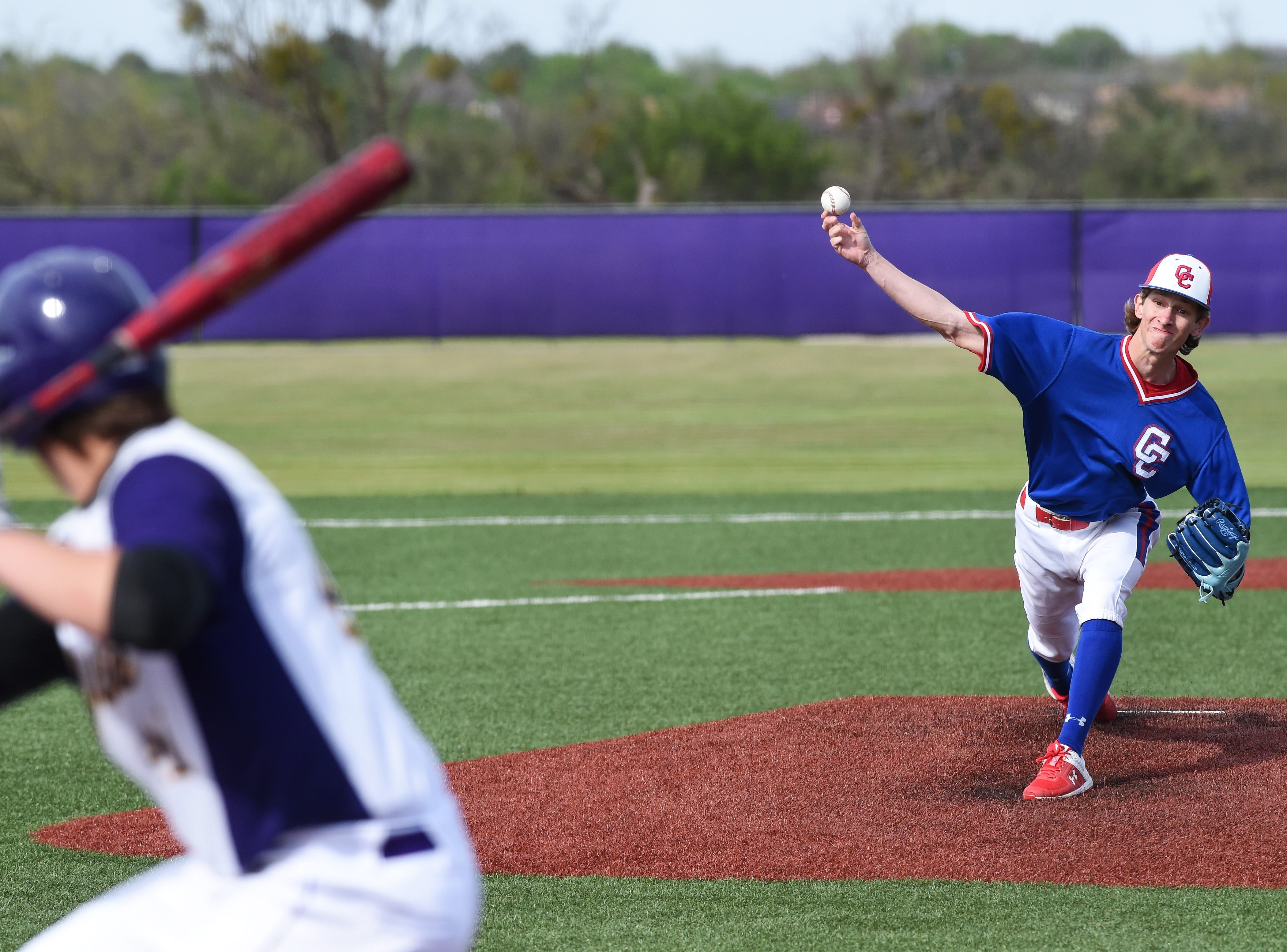 Cooper's Matthew Shira pitches to Wylie's Tyler Spears (41) at Bulldog Field on Friday, April 12, 2019. The Bulldogs won 4-3.