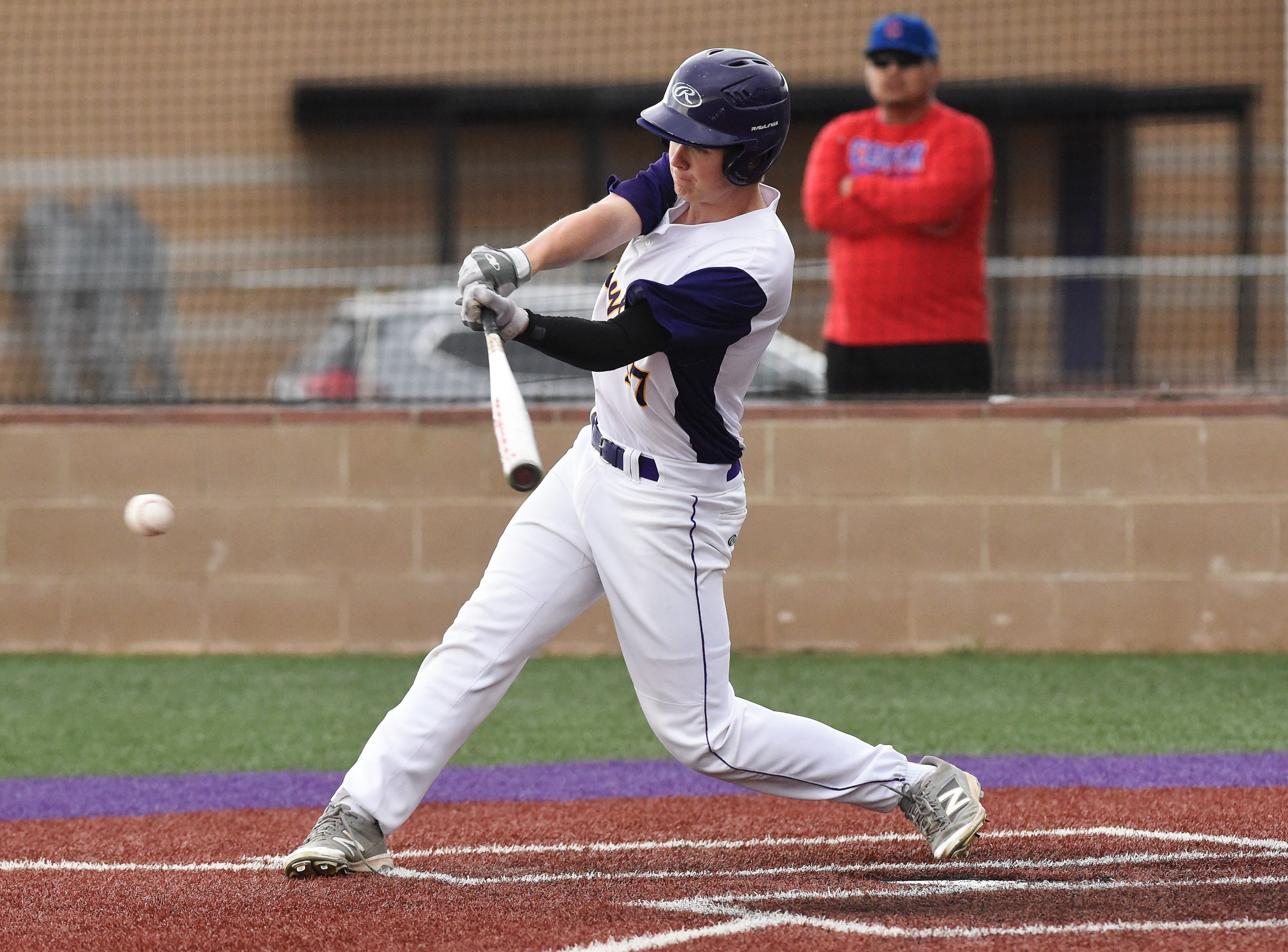 Wylie's Reed Hughes (27) connects on a pinch hit single against Cooper at Bulldog Field on Friday, April 12, 2019. The Bulldogs won 4-3.
