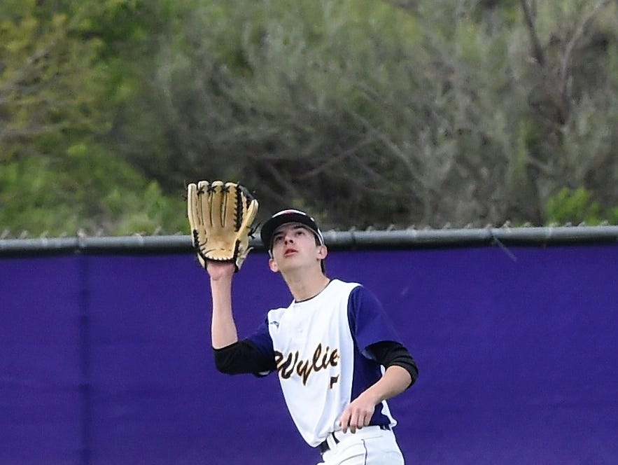 Wylie left fielder Dash Albus (7) looks in a fly ball against Cooper at Bulldog Field on Friday, April 12, 2019. The Bulldogs held on to win 4-3.