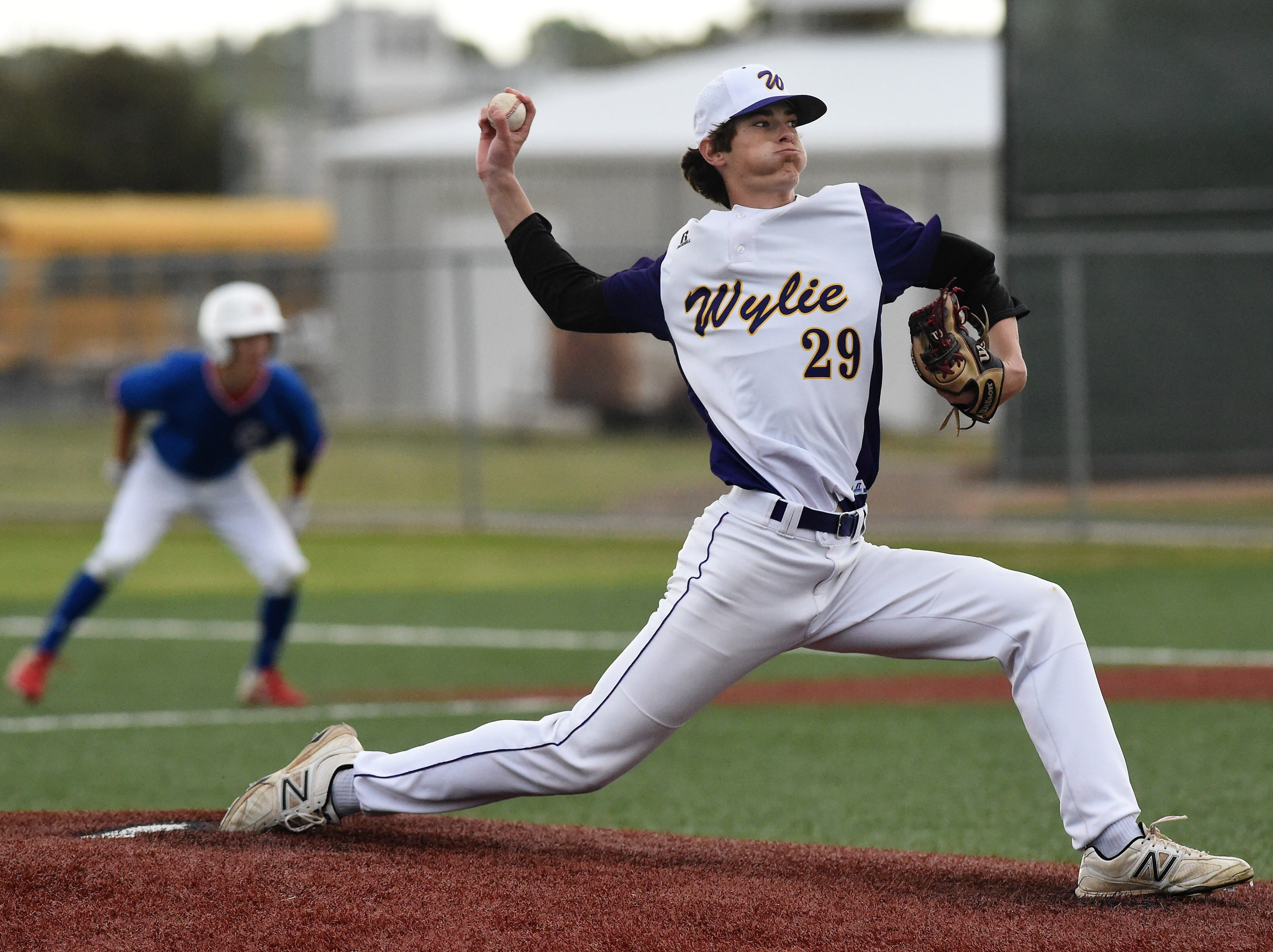 Wylie reliever Walker Piland (29) pitches against Cooper at Bulldog Field on Friday, April 12, 2019.