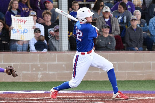Cooper designated hitter J.D. Creel (22) follows through on a single against Wylie at Bulldog Field on Friday, April 12, 2019. The Cougars fell 4-3.