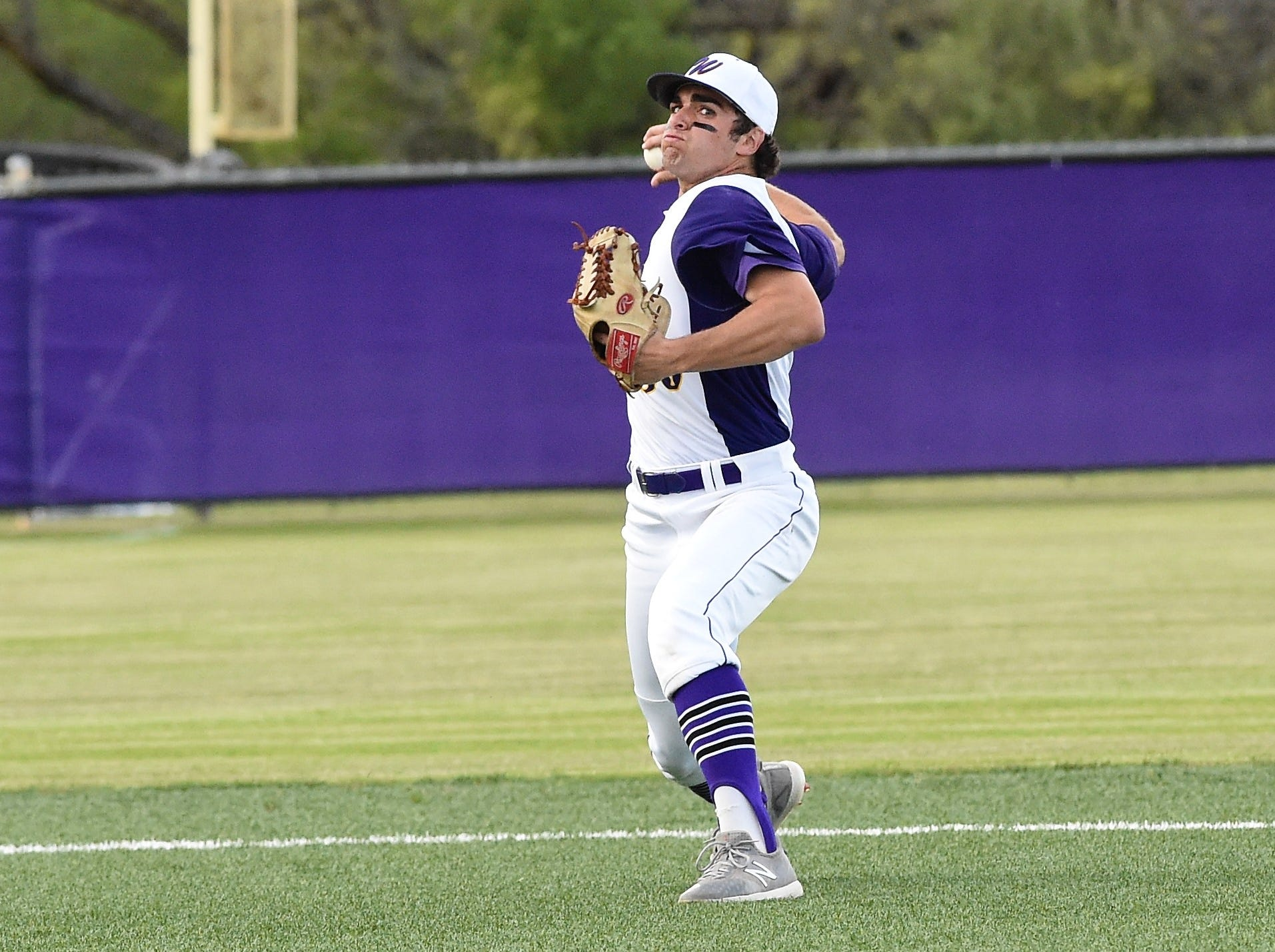 Wylie shortstop Jaxon Hansen (39) sets to throw to first for an out against Cooper at Bulldog Field on Friday, April 12, 2019. Hansen had six assists in the 4-3 win.
