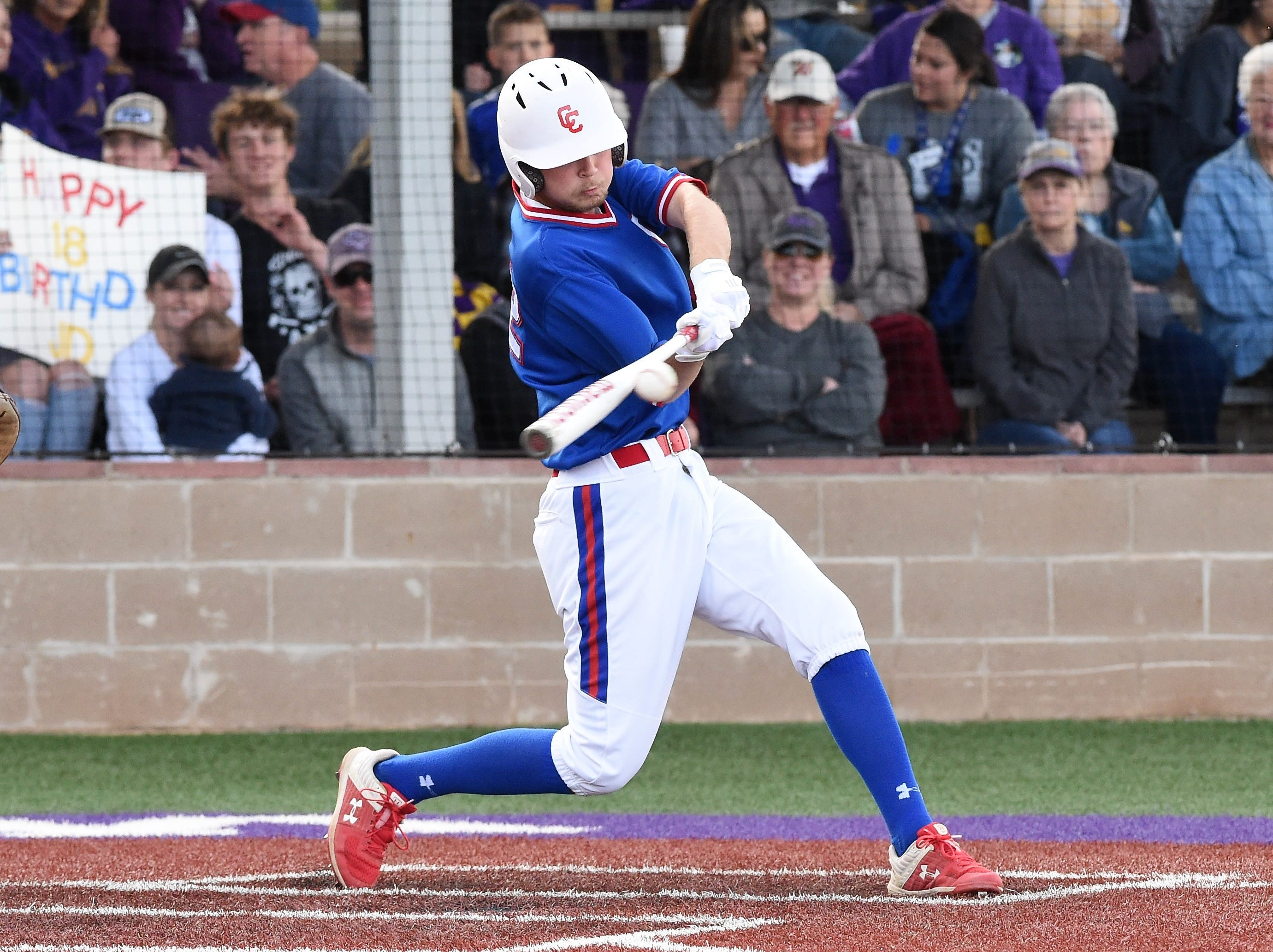 Cooper's J.D. Creel (22) makes contact against Wylie at Bulldog Field on Friday, April 12, 2019. Creel had a hit and a walk in the 4-3 loss.