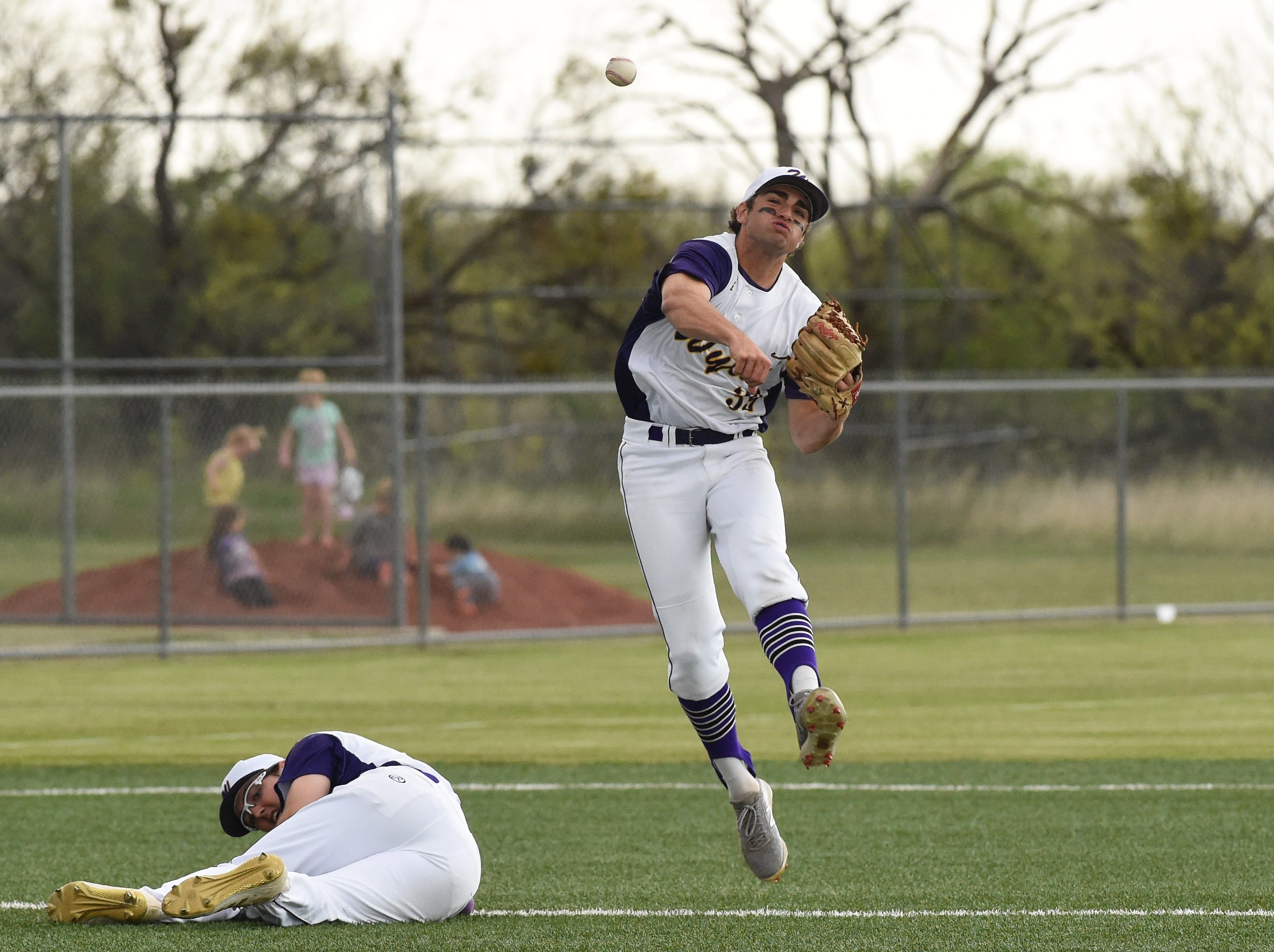 Wylie shortstop Jaxon Hansen (39) fires to first for an out against Cooper at Bulldog Field on Friday, April 12, 2019. Hansen accounted for six outs in the 4-3 win.