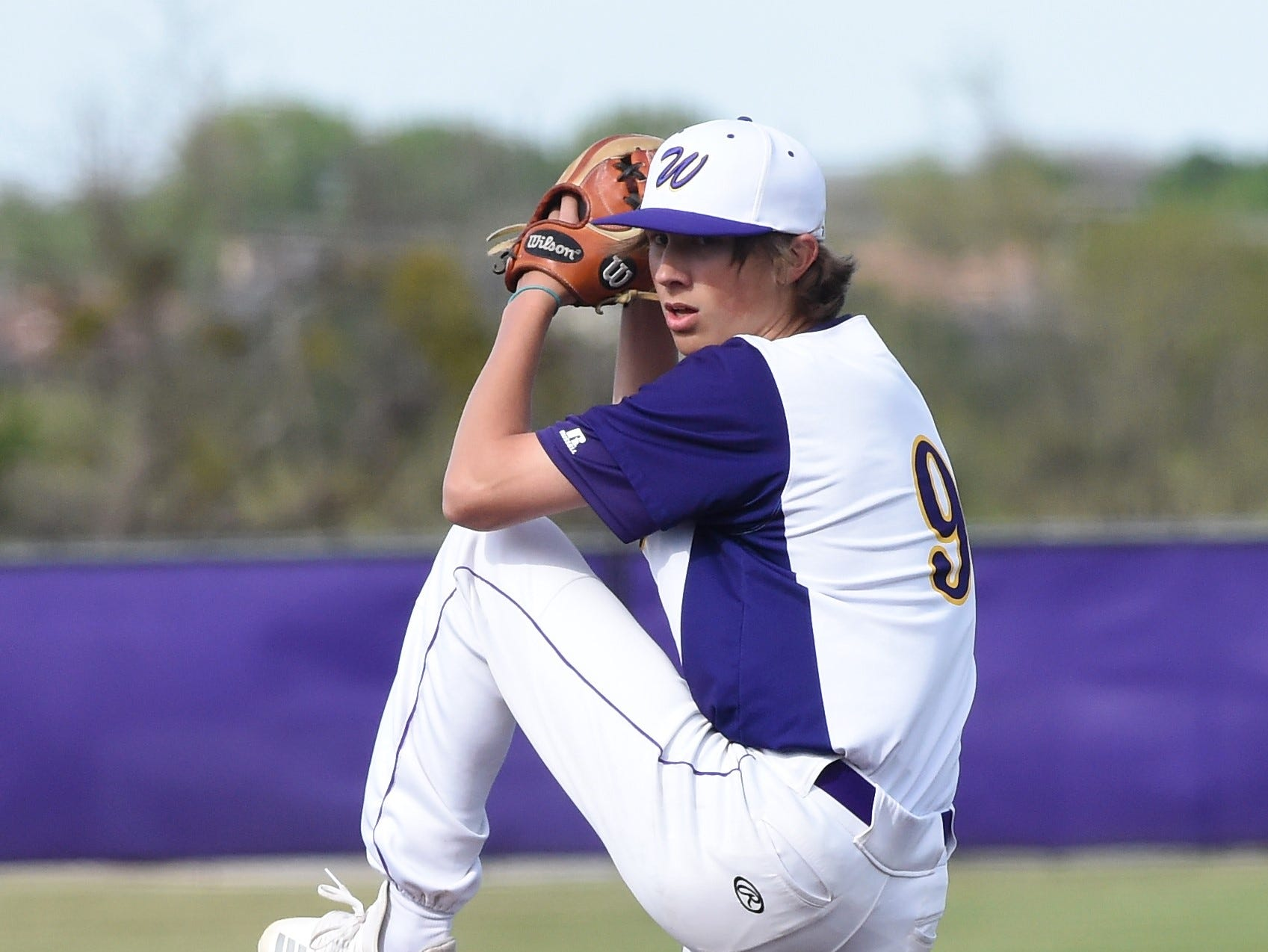 Wylie pitcher Brooks Gay (9) goes through his windup against Cooper at Bulldog Field on Friday, April 12, 2019. Gay allowed one unearned run in six innings of work to earn the 4-3 win.