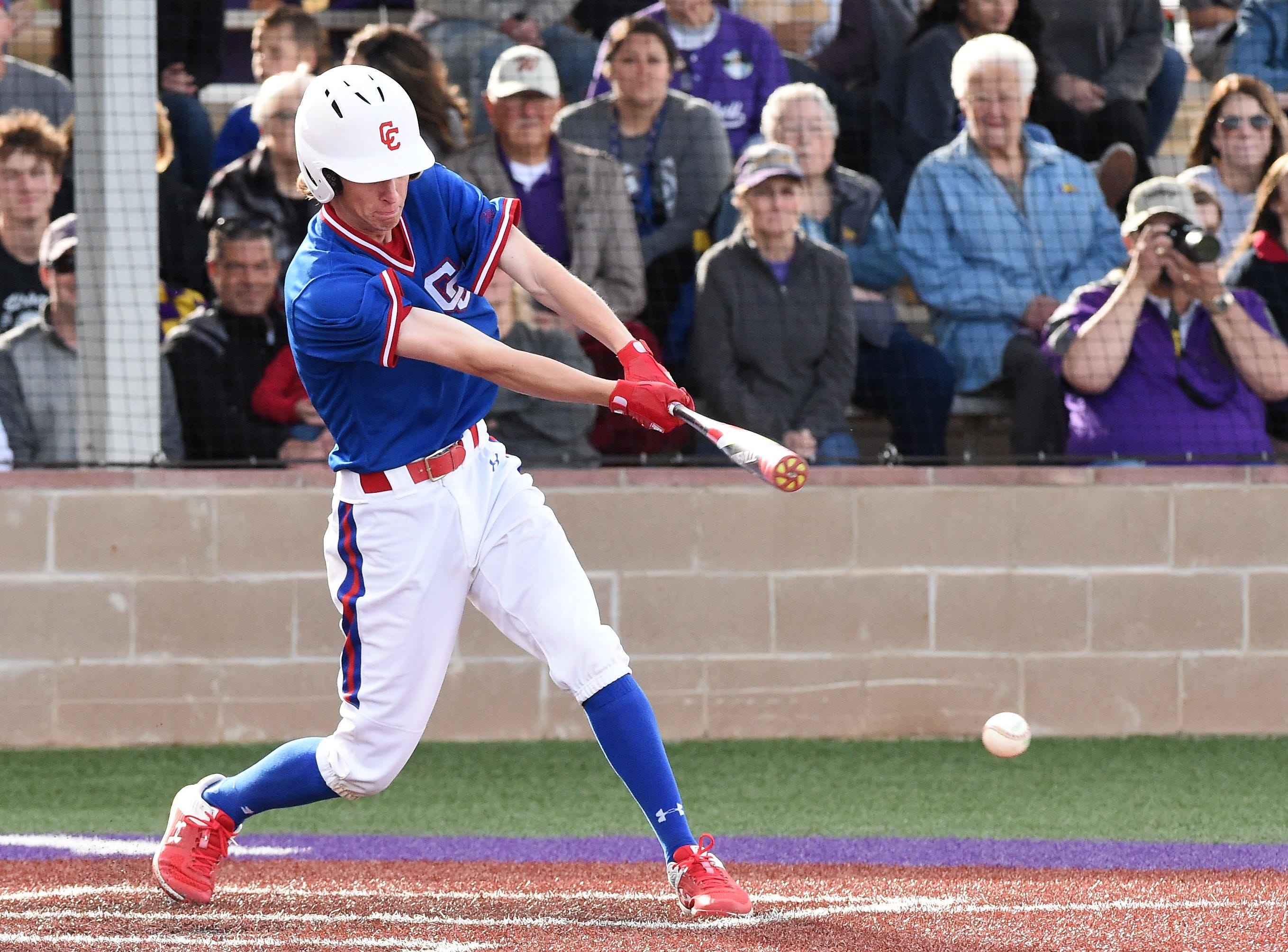 Cooper's Matthew Shira (8) puts the ball in play against Wylie at Bulldog Field on Friday, April 12, 2019. Shira earned a walk and pitched a complete-game in the 4-3 loss.