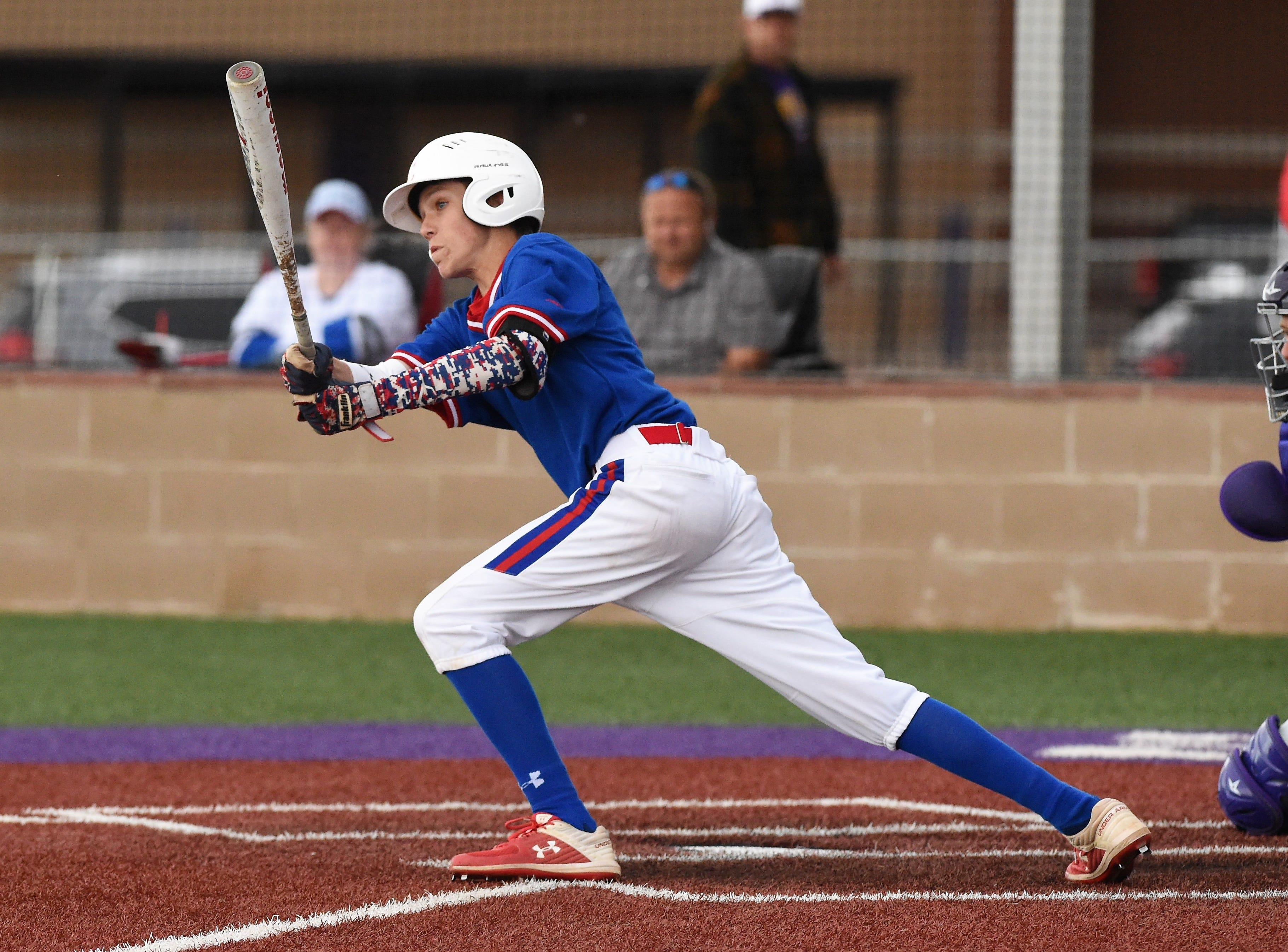 Cooper's Jack Keefer (2) follows through on a swing against Wylie at Bulldog Field on Friday, April 12, 2019. The Cougars fell 4-3.