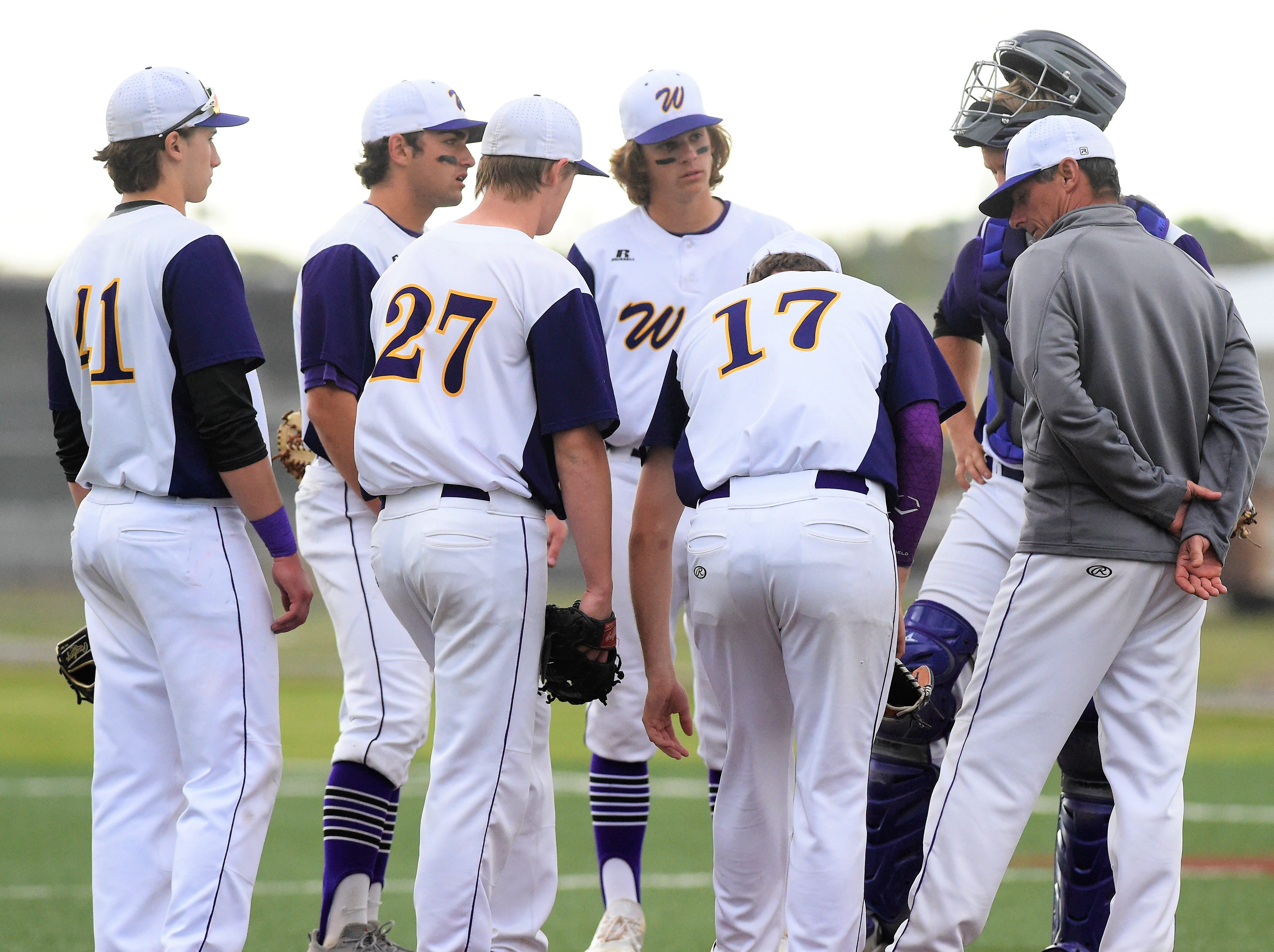 Wylie coach Clay Martin meets with his team on the mound during the seventh inning against Cooper at Bulldog Field on Friday, April 12, 2019. The Bulldogs held on for the 4-3 win.