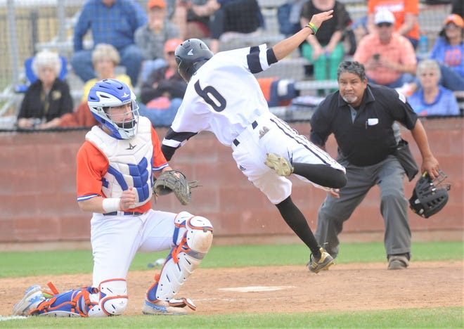 Abilene High's Isaiah Albarado (6), expecting a play at the plate, dives around San Angelo Central catcher Nixon Brannan to score a run in the third inning. Albarado, the courtesy runner for AHS catcher Matt Ezzell, scored on Reese Pettijohn's hit in the inning for a 9-4 lead. There was no play as the ball skipped past Brannan. The Eagles beat Central 12-8 in the District 3-6A game Friday, April 12, 2019, at Blackburn Field.