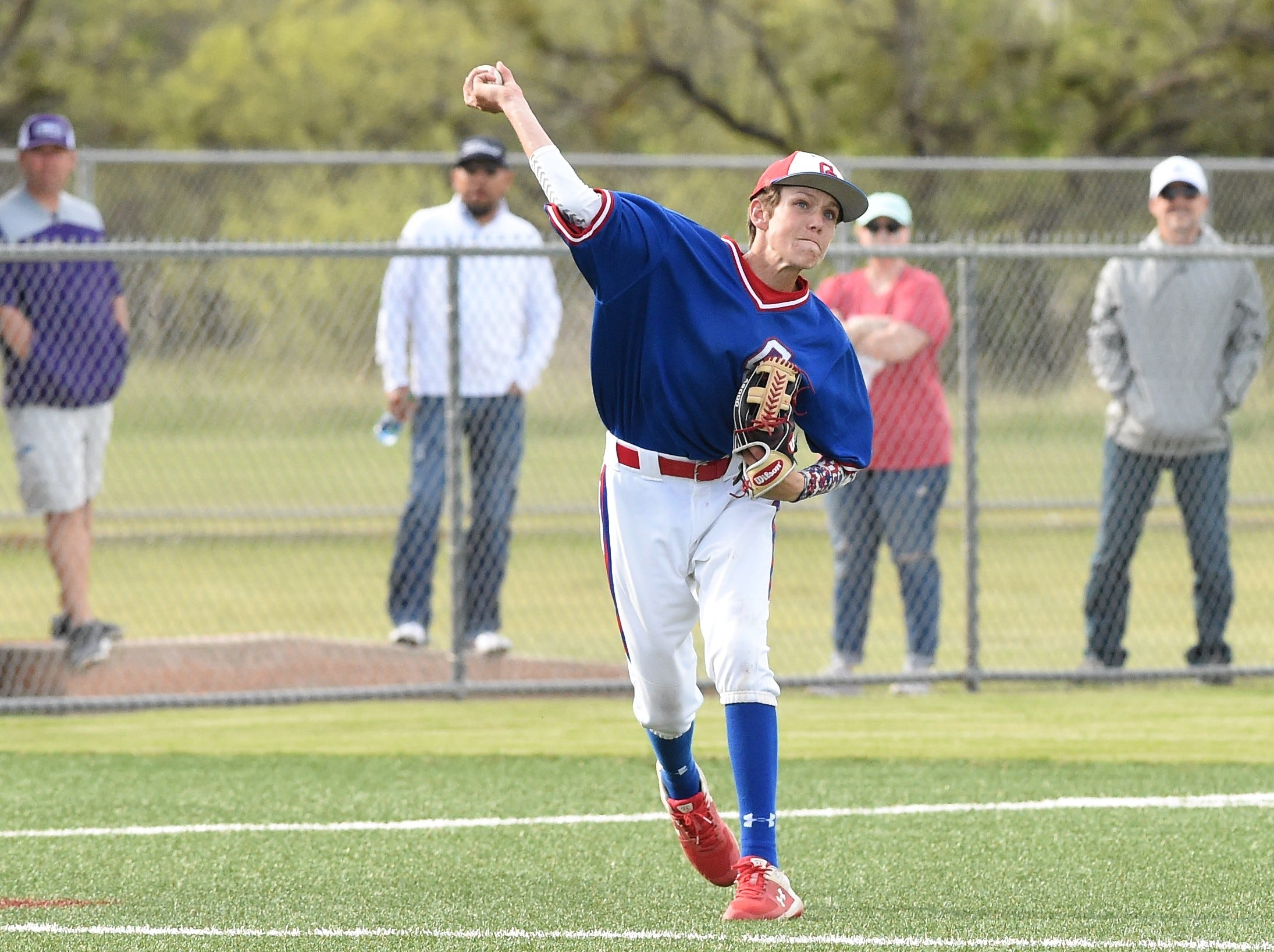 Cooper third baseman Jack Keefer (2) throws to first for an out against Wylie at Bulldog Field on Friday, April 12, 2019. The Cougars fell 4-3.