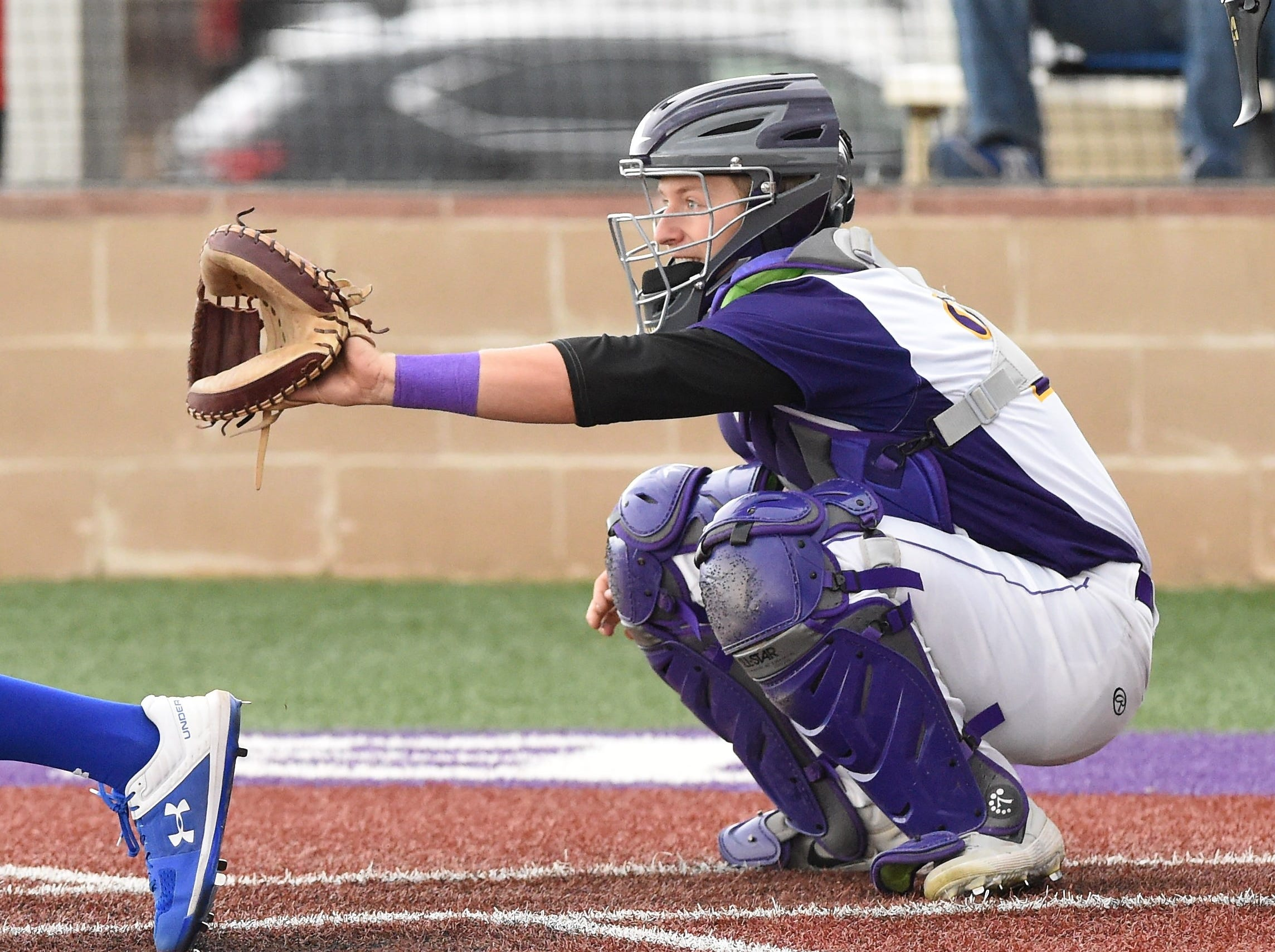 Wylie catcher Caleb Munton (25) gets set behind the plate against Cooper at Bulldog Field on Friday, April 12, 2019.