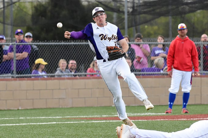 Wylie third baseman Kanon Doby (17) throws to first base for an out against Cooper at Bulldog Field on Friday, April 12, 2019. Doby had two hits and an RBI in the 4-3 win.