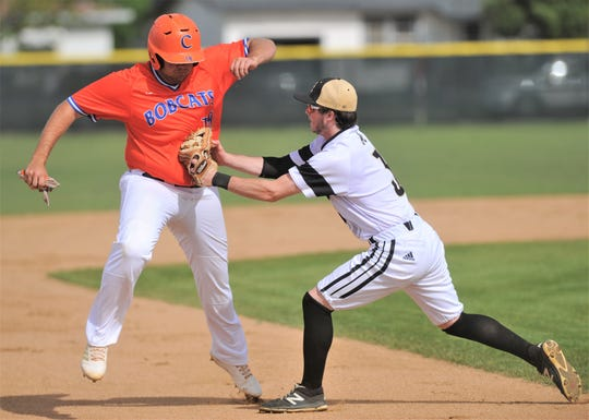 Abilene High third baseman Ethan Flanders, right, tags out San Angelo Central's Dawson Daniel on Jakob Charles' fielder's choice ground ball to third in the second inning for the second out with runners at first and second. The Eagles beat Central 12-8 in the District 3-6A game Friday, April 12, 2019, at Blackburn Field.
