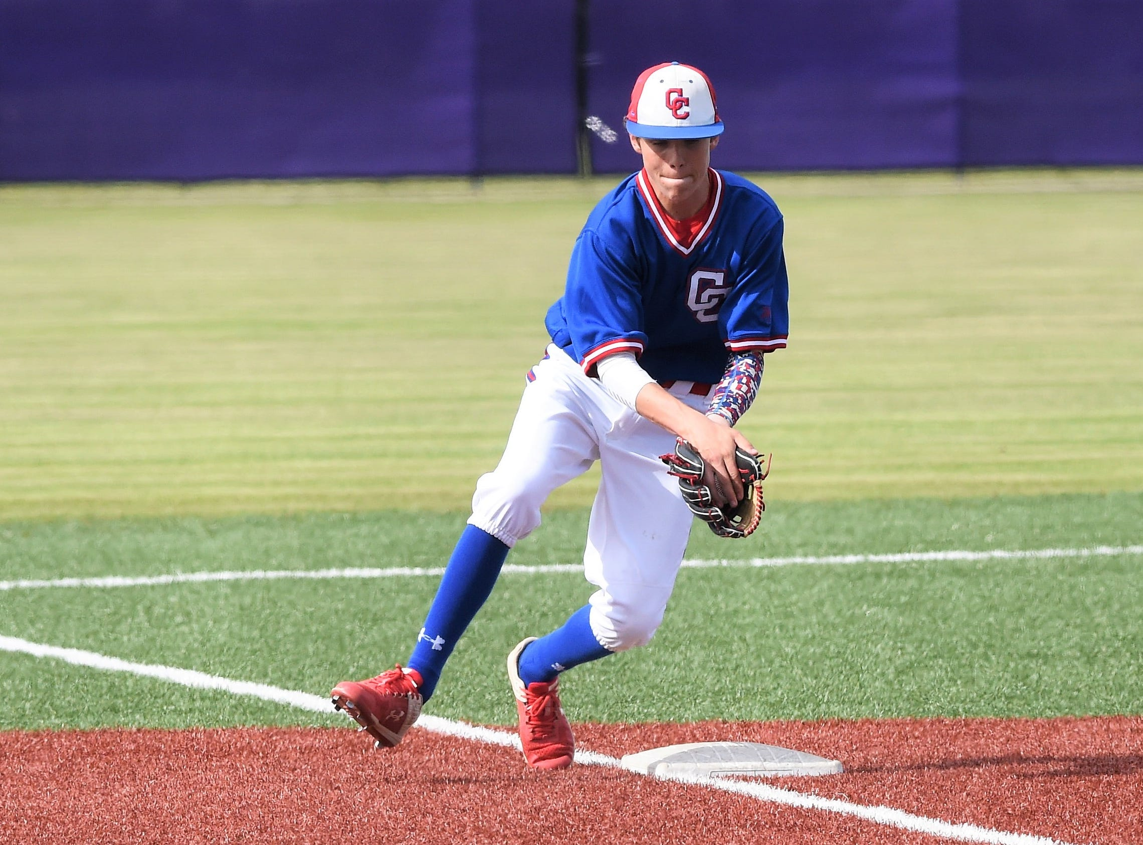 Cooper third baseman Jack Keefer (2) snags a grounder before getting the out at first against Wylie at Bulldog Field on Friday, April 12, 2019. Keefer had a hit, walked twice and scored in the 4-3 loss.