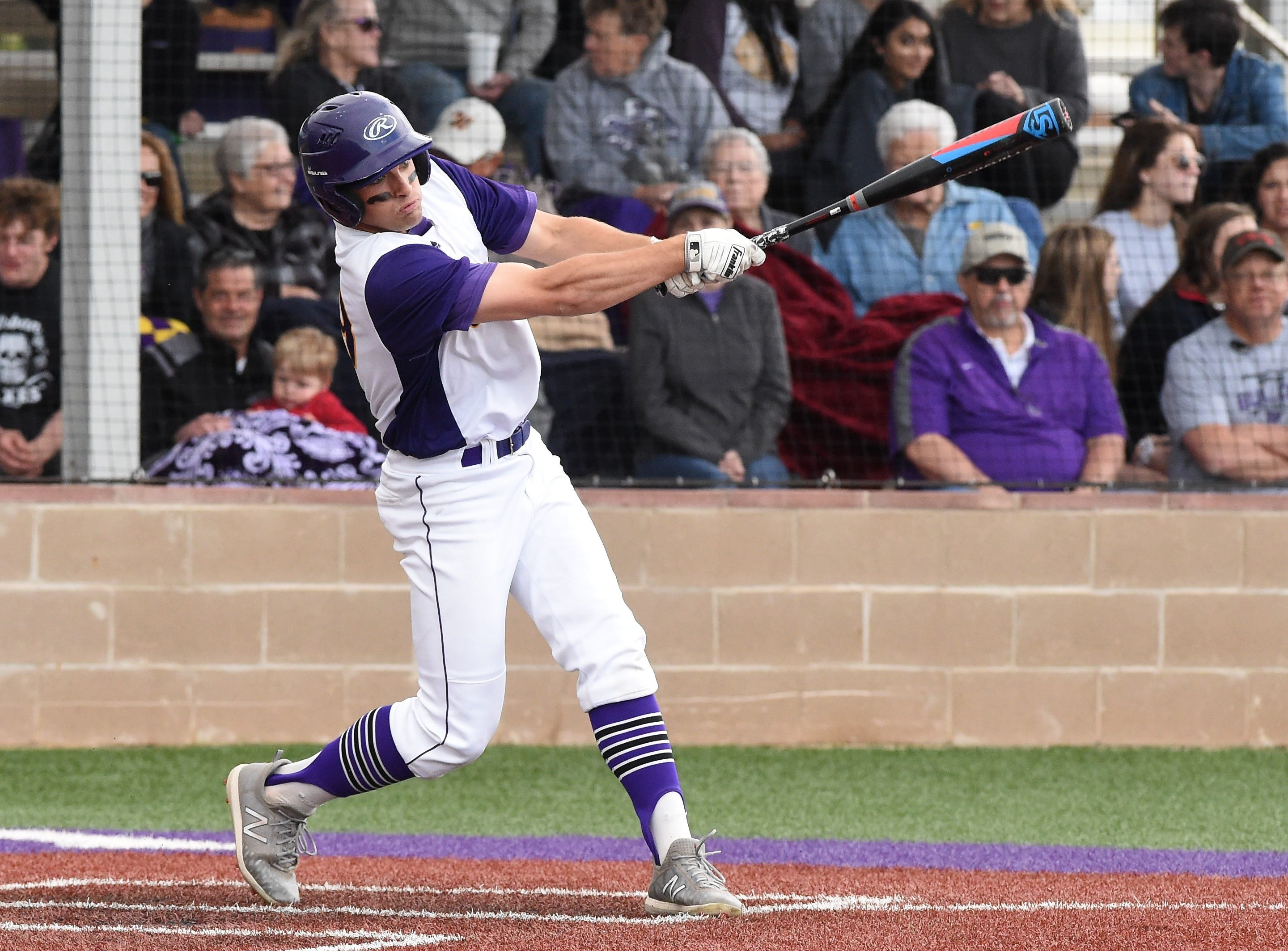 Wylie's Jaxon Hansen (38) follows through on a base hit against Cooper at Bulldog Field on Friday, April 12, 2019. Hansen helped the Bulldogs to a 4-3 win.