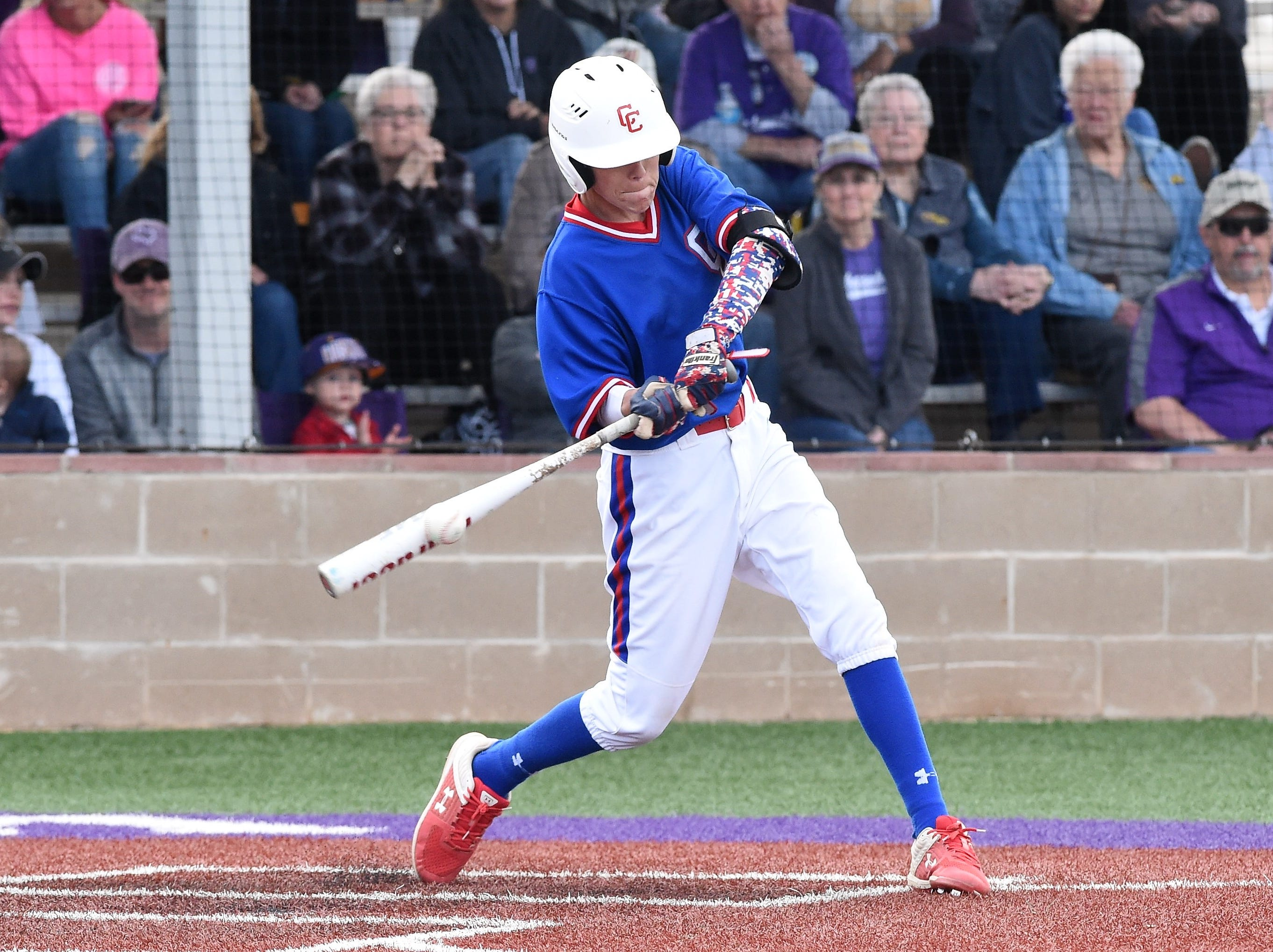 Cooper's Jack Keefer (2) connects on a base hit against Wylie at Bulldog Field on Friday, April 12, 2019. Keefer also drew two walks and scored in the 4-3 loss.