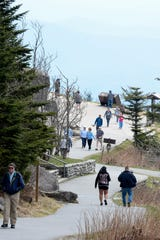 Hikers walk up and down the path to Clingmans Dome at Great Smoky Mountain National Park April 10, 2019.