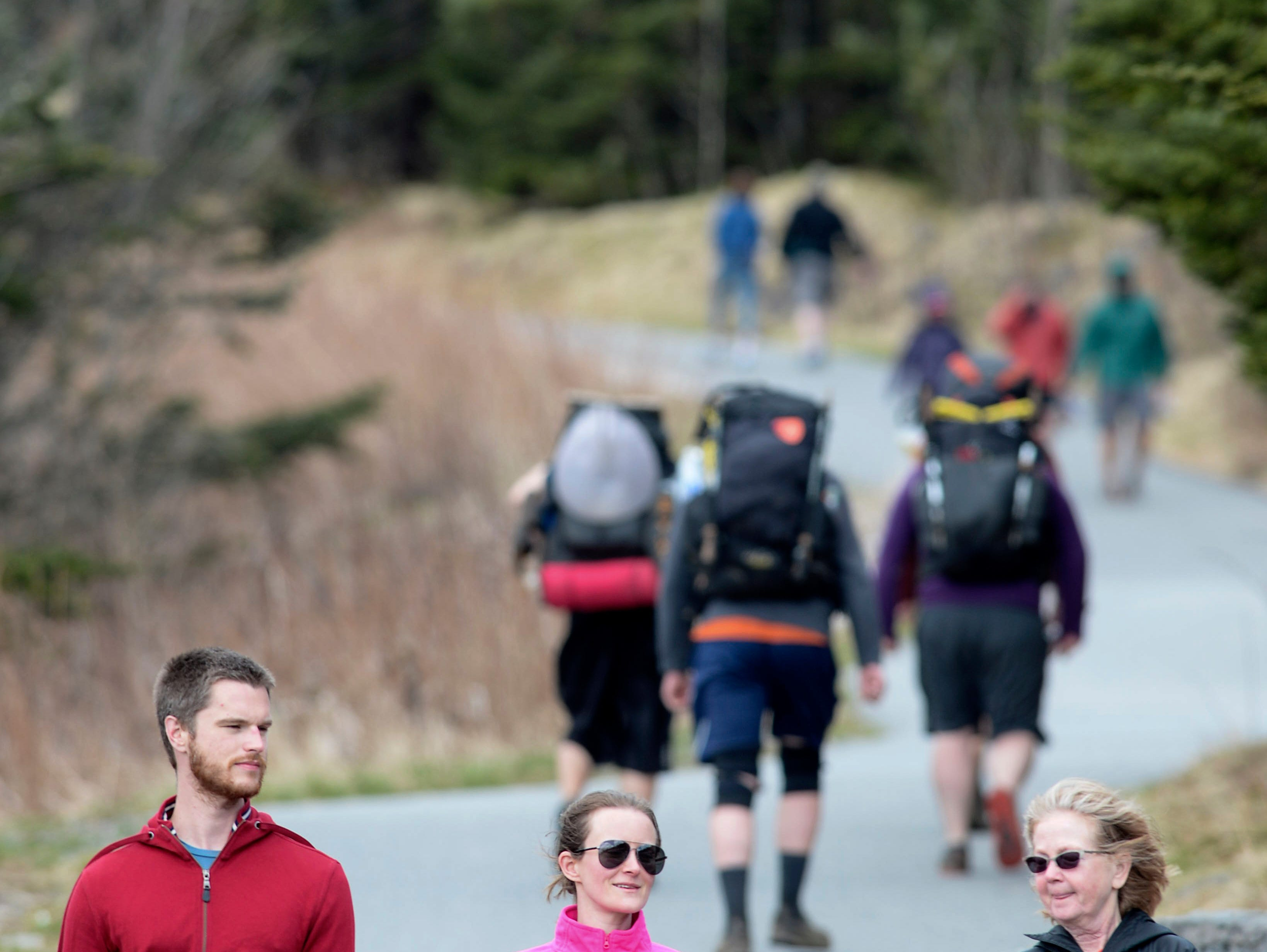 Hikers walk along the Clingmans Dome trail in Great Smoky Mountains National Park April 11, 2019.