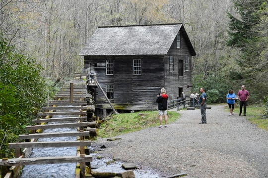 Visitors to the Great Smoky Mountains National Park check out Mingus Mill April 11, 2019.