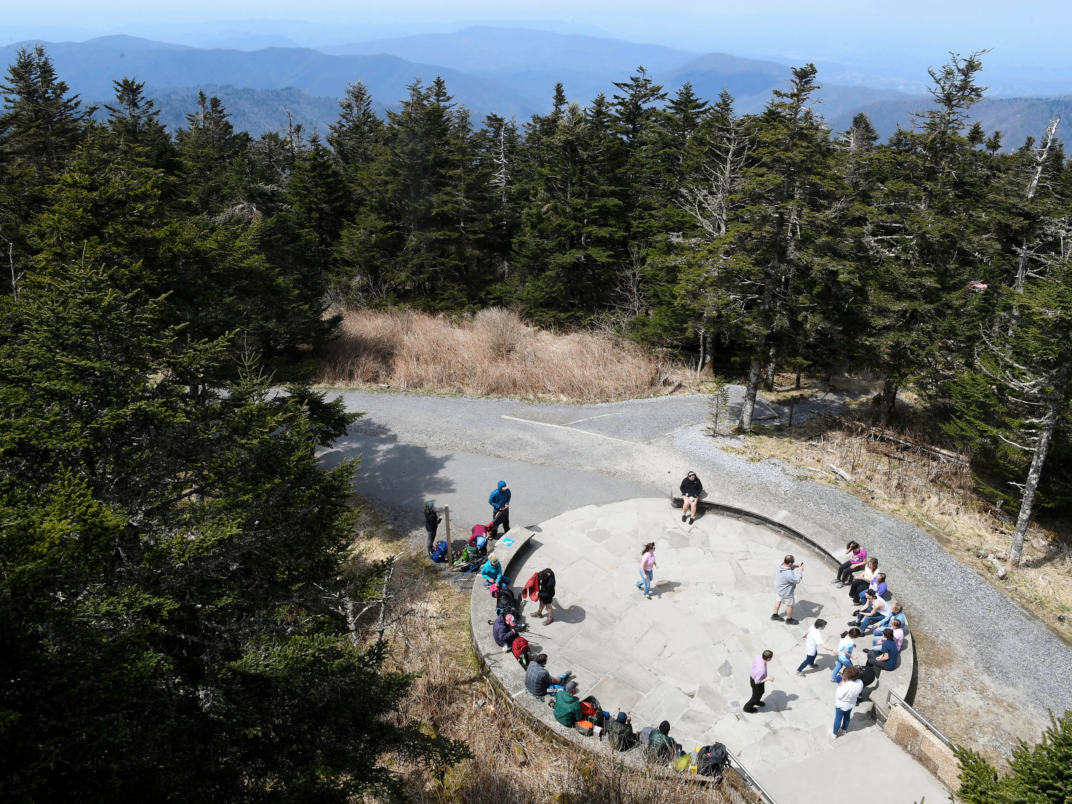 Hikers rest under the Clingmans Dome structure at Great Smoky Mountain National Park April 10, 2019.