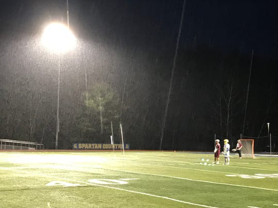 Rain comes down heavily during Johnson City's 16-6 Section 4 Conference victory Friday night at Maine-Endwell.