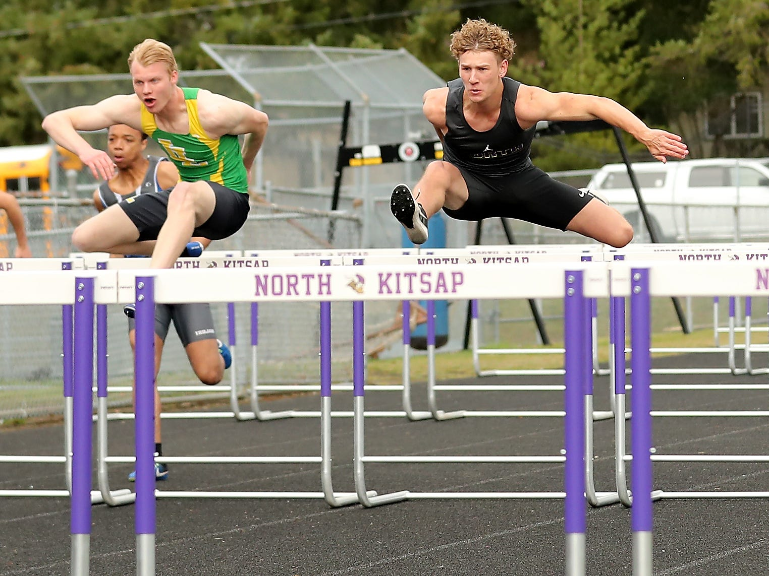 North Kitsap's Andrew Blackmore (center) clears a hurdle during the 110 Meter Hurdles at the Lil' Norway Invitational on Saturday, April13, 2019.
