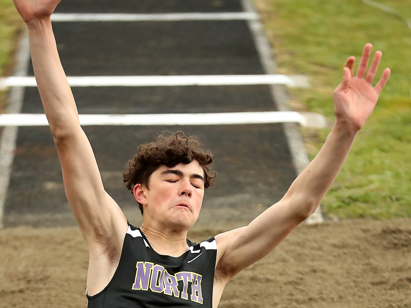 North Kitsap's Jonas La Tour hits the dirt while competing in the triple jump during the Lil' Norway Invitational at North Kitsap High School in Poulsbo on Saturday, April13, 2019.