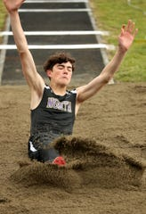 North Kitsap's Jonas La Tour hits the sand while competing in the triple jump during the Lil' Norway Invitational at North Kitsap High School in Poulsbo on Saturday, April 13, 2019.