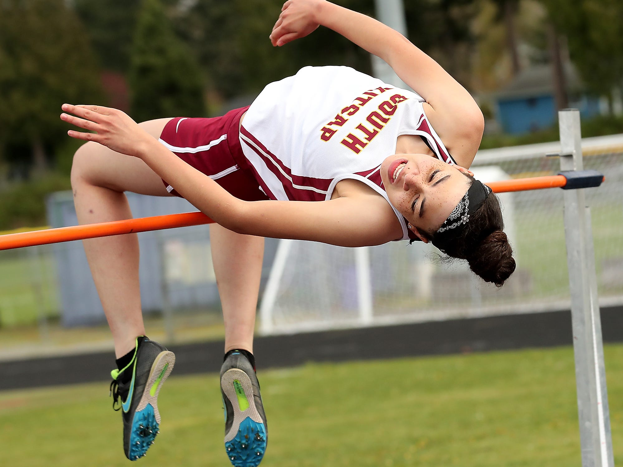 South Kitsap's Audrey Green catches the high jump bar during the Lil' Norway Invitational at North Kitsap High School in Poulsbo on Saturday,  April13, 2019.