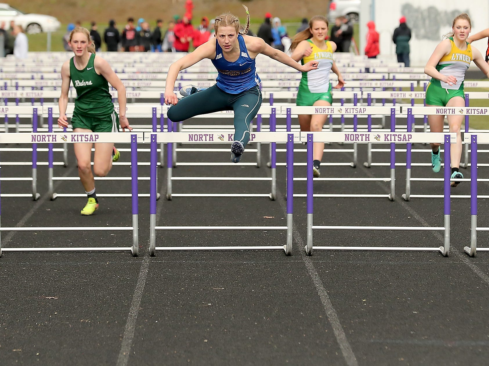 Bremerton's Lauryn Chandler clears the last hurdle for a first place finish in toe 100 Meter Hurdles at the Lil' Norway Invitational on Saturday, April13, 2019.