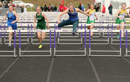 Bremerton's Lauryn Chandler clears the last hurdle for a first-place finish in the 100-meter hurdles at the Lil' Norway Invitational in Poulsbo on Saturday, April 13, 2019.