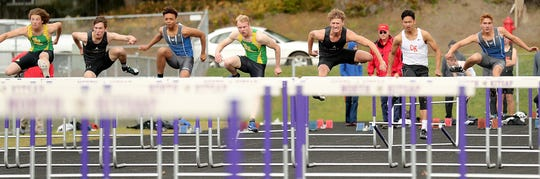 The first set of hurdles are cleared in the boys 110-meter hurdles race during the Lil' Norway Invitational at North Kitsap High School in Poulsbo on Saturday, April 13, 2019.