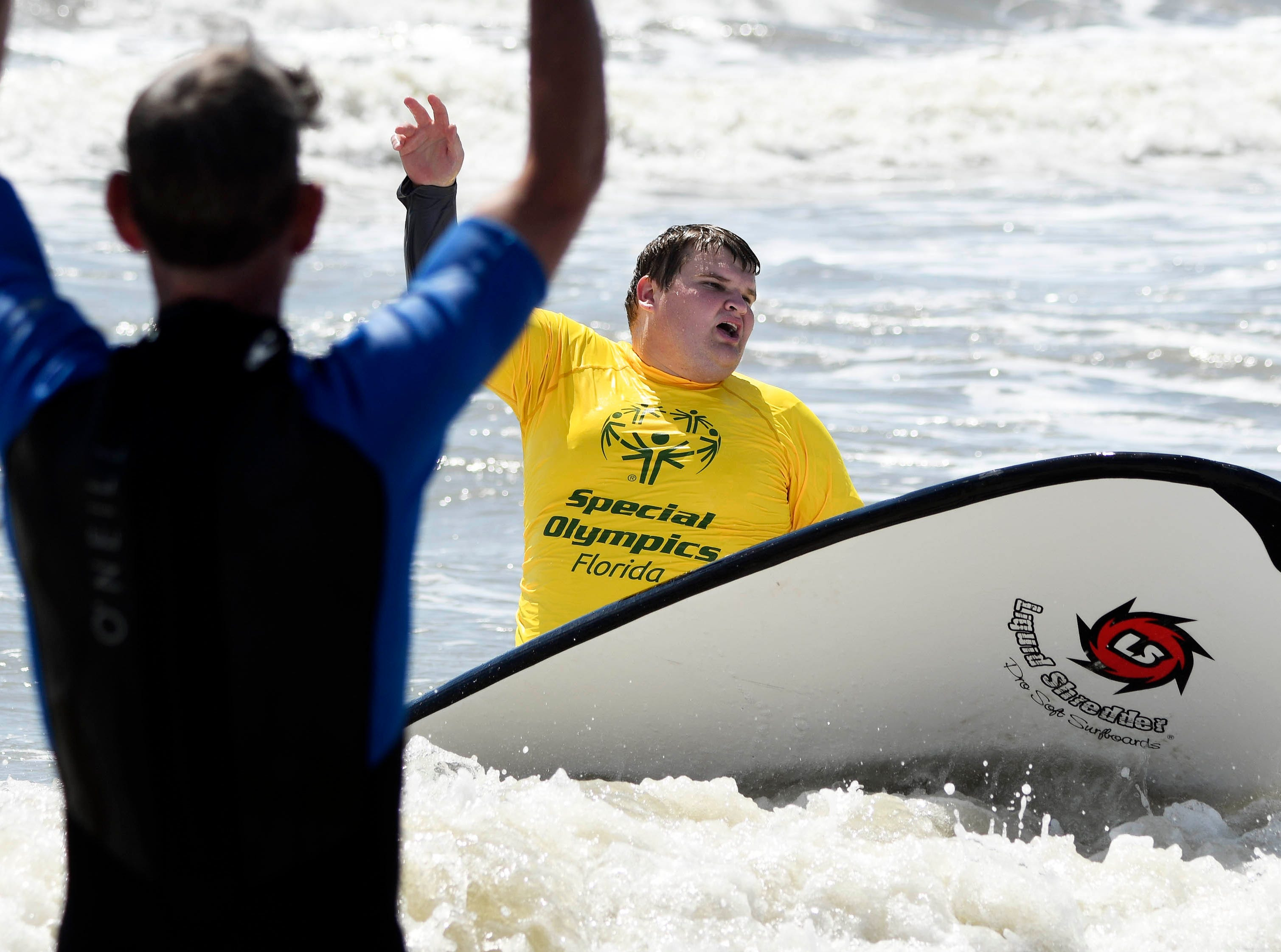 Jacob Nehus participates in the Special Olympics spring surfing festival at Shepard Park.