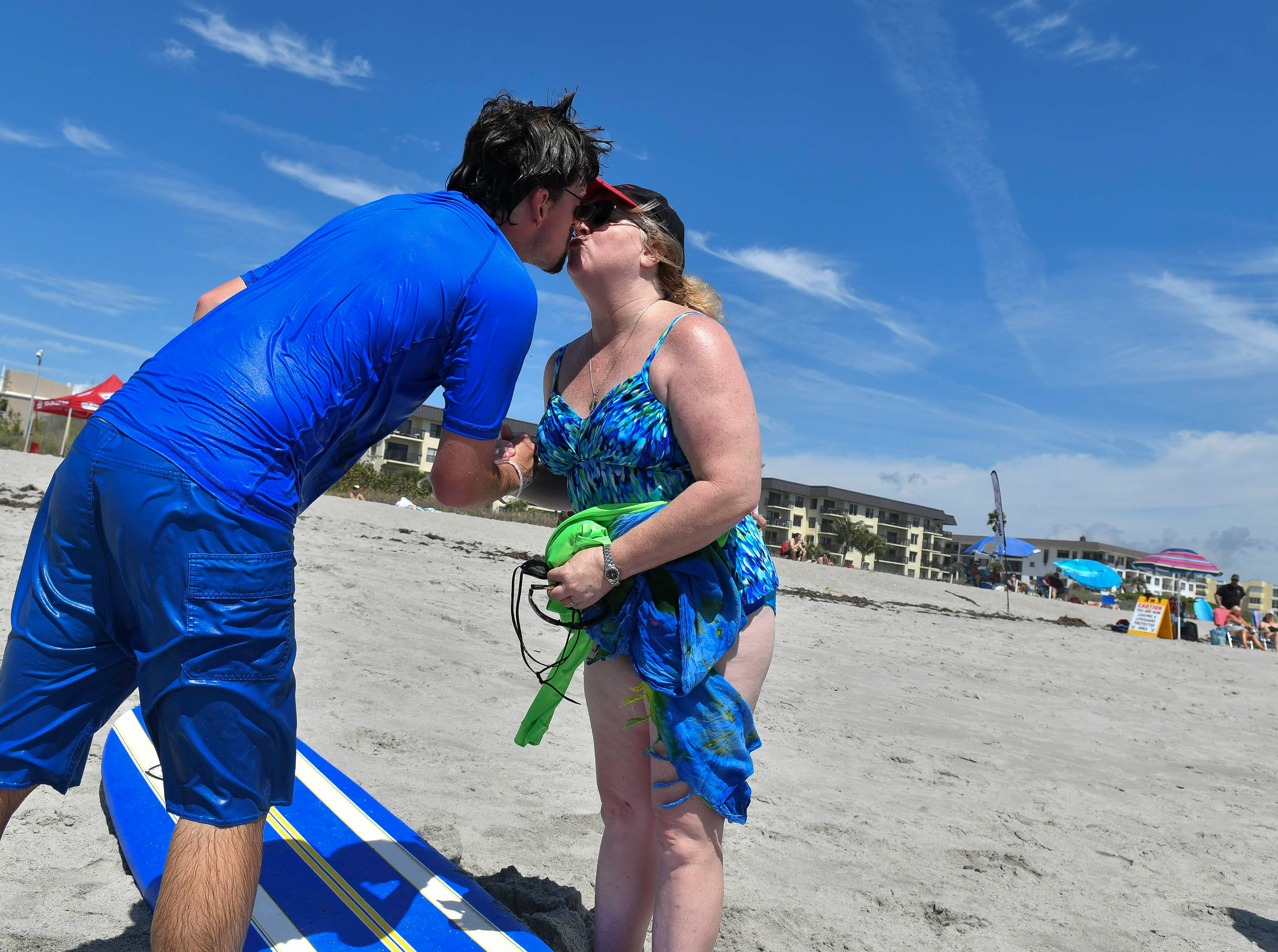 Peggy Hutchison-Padron high kisses her son Bryan Padron after he finished competing in the Special Olympic spring surfing festival at Shepard Park.