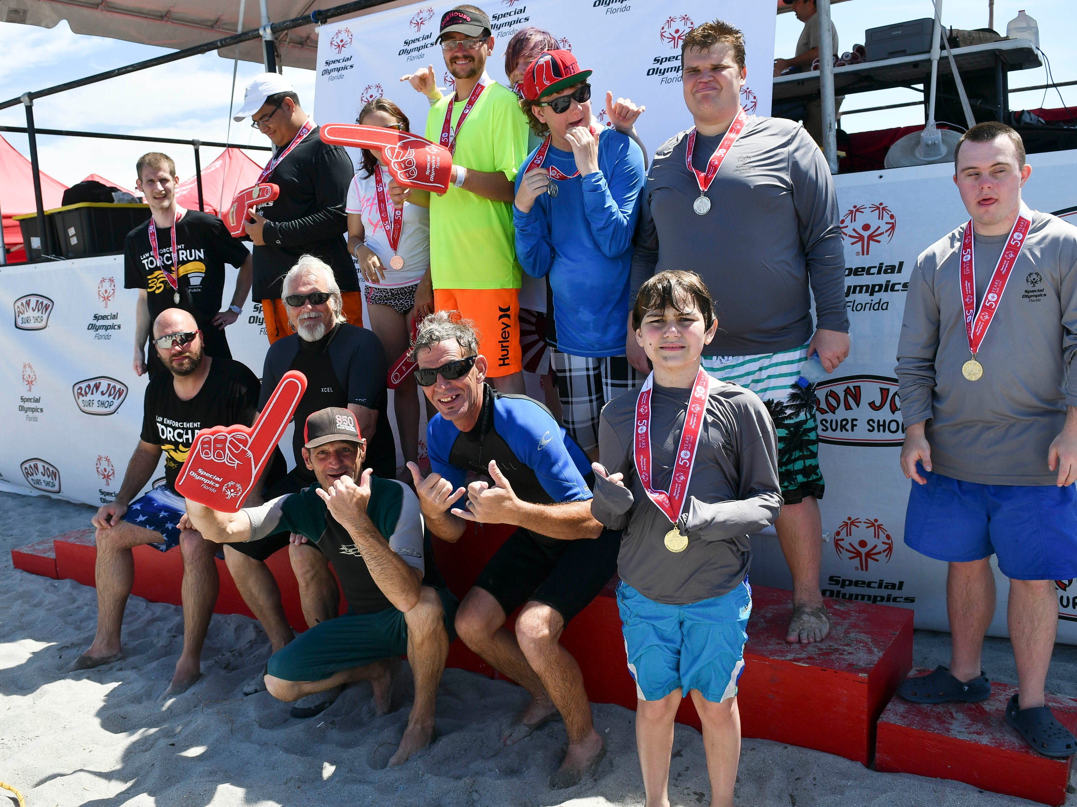 Members of the Okaloosa County group pose for pictures during the Special Olympic spring surfing festival at Shepard Park in Cocoa Beach.